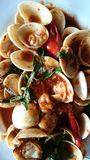 Thai seafood. Stir-fired venus shell with roasterd chili past Royalty Free Stock Images
