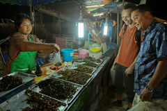 Thai seller selling to tourists cockroaches royalty free stock photography