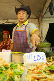 Thai seller in the street market Royalty Free Stock Image