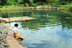 Thai Senior Relaxing Outdoor Thermal Pool Royalty Free Stock Photo