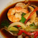 Thai shrimps and vegetables. Served in a restaurant in italy royalty free stock images
