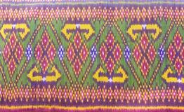 Thai siam fabric silk Full color pattern texture. Thai Handmade woven Thai Silk fabric silk Full color pattern and texture stock images