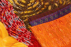 Thai silk cloths and raw silk threads material Stock Image