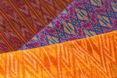 Thai silk cloths and raw silk threads material Stock Photography