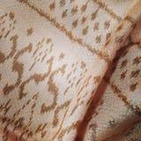 Thai Silk. Thai esan silk , cream golden color Stock Photos