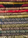 Thai silk fabric folded and stacked Stock Image