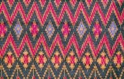 Thai silk fabric pattern background Royalty Free Stock Photo