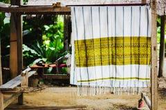 Thai silk fabrics hang drying royalty free stock photos