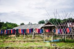 Thai silk fabrics hang drying in the wind, in the Nan stock images