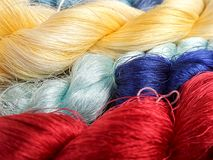 Thai silk thread for weaving in wooden loom Royalty Free Stock Photo