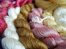 Thai silk thread for weaving in wooden loom Royalty Free Stock Photos
