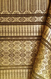 Thai silk weave by handmade 1. Thai silk weave by handmade with the golden and brown fabric stock photo