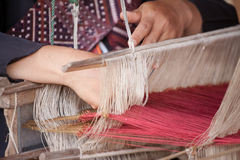 Thai Silk weaving. Process of weaving, dyeing textile materials used in making dye nature of ancient Thailand as silk royalty free stock photo