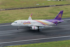Thai smile airway plane landing at Phuket Airport Royalty Free Stock Images