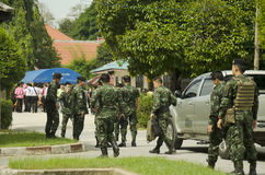 Thai soldiers walking go to checkpoint guardhouse for protect an. D security at wat khuha sawan on July 13, 2016 in Yala province of southern Thailand Royalty Free Stock Images