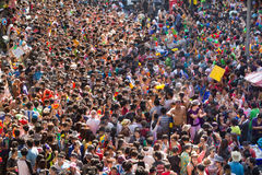 Thai songkran festival. BANGKOK - APRIL 15 2011: Crowd of people dancing and throwing water in Silom road during the Songkran buddhist New Year Festival Stock Image