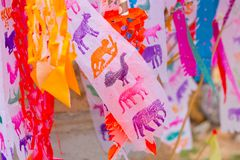 Thai Songkran festival culture colors zodiac paper flag. Thai Songkran festival culture colors paper flag in carrying sand at the temple during April Songkran Stock Photos