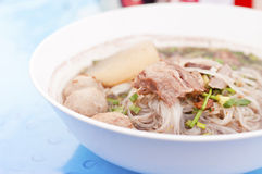Thai soup. With sliced pork and meatballs Stock Image