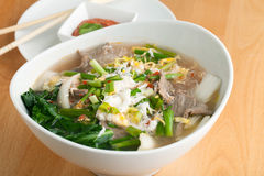 Thai Soup with Beef. Closeup of some Thai pho style soup with beef and clear rice noodles royalty free stock image