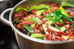 Thai soup. Dried chili fruits and lemon leaves in a large pot Royalty Free Stock Photography