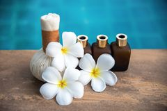 Thai Spa composition treatments aroma therapy for relax body with Plumeria flowers. Near swimming pool. Healthy Concept royalty free stock photo