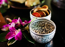 Thai Spa herb. Thai Spa herb, ginger, powder,sesame, in plate on black table stock photography