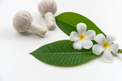 Thai Spa massage compress balls, herbal ball and treatment  spa, relax and healthy care with white flower, Thailand. Healthy Concept. select focus Royalty Free Stock Image