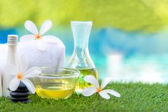 Thai Spa massage compress balls, herbal ball and treatment spa,. Relax and healthy care with flower near swimming pool, Thailand. Healthy Concept Stock Image