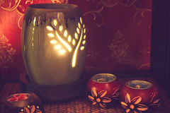 Thai spa massage setting with aroma oil and candles. Royalty Free Stock Photos