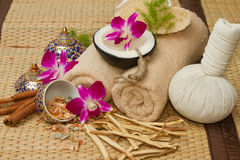 Thai spa massage setting , Massage oil, body scrub, Towels,Cinna Royalty Free Stock Photo