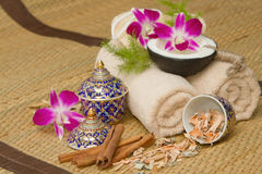 Thai spa massage setting with spa essential oil. Towel, herb ,natural luffa Sponge and with orchid stock images