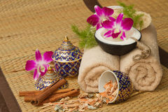 Thai spa massage setting with spa essential oil , towel, herb ,. Natural luffa Sponge and with orchid stock image