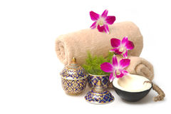 Thai spa massage setting with spa essential oil. Towel, organic soap and orchid royalty free stock photo