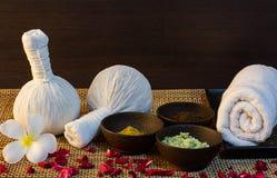 Thai spa massage setting on wood pattern background Royalty Free Stock Image