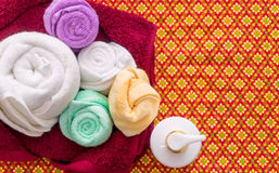 Thai Spa Massage towels and soup on orange pattern royalty free stock photos