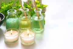 Thai Spa Treatments aroma therapy salt and nature green sugar scrub and rock massage with green orchid flower. On wooden white with candle. Thailand. Healthy Royalty Free Stock Photos
