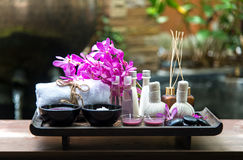 Thai Spa Treatments aroma therapy  salt and sugar scrub and rock massage with orchid flower.  Healthy Concept Stock Photo