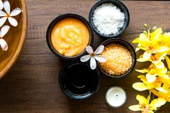 Thai Spa Treatments aroma therapy salt and sugar scrub and rock massage. With yellow orchid flower on wooden. Healthy Concept stock images