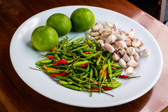 Thai spices on white dish. On the table Stock Photos