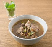Thai Spicy Beef Entrails Soup with Sweet Basil. Thai Cuisine and Food, A Bowl of Delicious Thai Clear Spicy Hot and Sour Soup with Beef Entrails Royalty Free Stock Photos