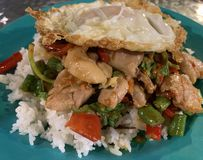 Thai spicy chicken basil with fried. Thai spicy chicken stir fried with basil on top with fried egg royalty free stock images