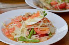 Thai spicy cuisine. Thai papaya salad hot and spicy ,mixed  vegetable ,dried salted prawn and egg Royalty Free Stock Photo