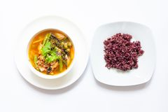 Thai spicy curry with rice berry in white bowl royalty free stock image