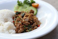 Thai spicy food basil pork fried rice recipe Phat Kra Pow Moo.  Royalty Free Stock Photography