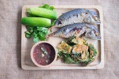 Thai spicy food nam prik kapi pla too. Fried mackerel with shrimp paste sauce and boiled or deep fresh vegetables famous Thai spicy food nam prik kapi pla too on Stock Images