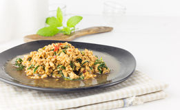 Thai spicy food  Stir fried chicken with basil Royalty Free Stock Images