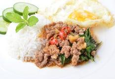 Thai spicy food, stir fried pork whit basil Royalty Free Stock Images