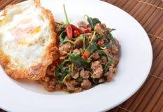 Thai spicy food, stir fried pork whit basil Stock Images