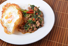 Thai spicy food, stir fried pork whit basil Royalty Free Stock Image