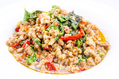 Thai spicy food, stir fried pork whit basil. On white background Stock Image